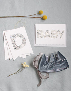 Luxury new baby boy gift box by The Charming Press featuring Liberty print personalised gifts.