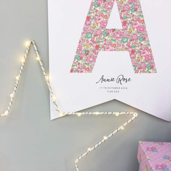 Close up of Betsy Ann Liberty print personalised Monogram flag by The Charming Press