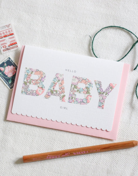 New baby greetings card featuring scallop edge and Liberty print lettering.