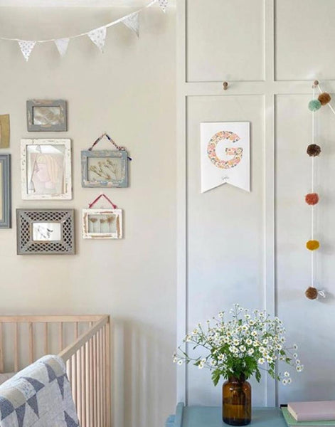 Nursery with wall art and prints including monogram nursery flag, personalised with Liberty fabric and child's initial.