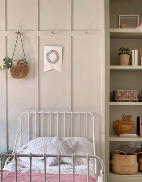 Child's bedroom with panelling accessories with hanging monogram flag.