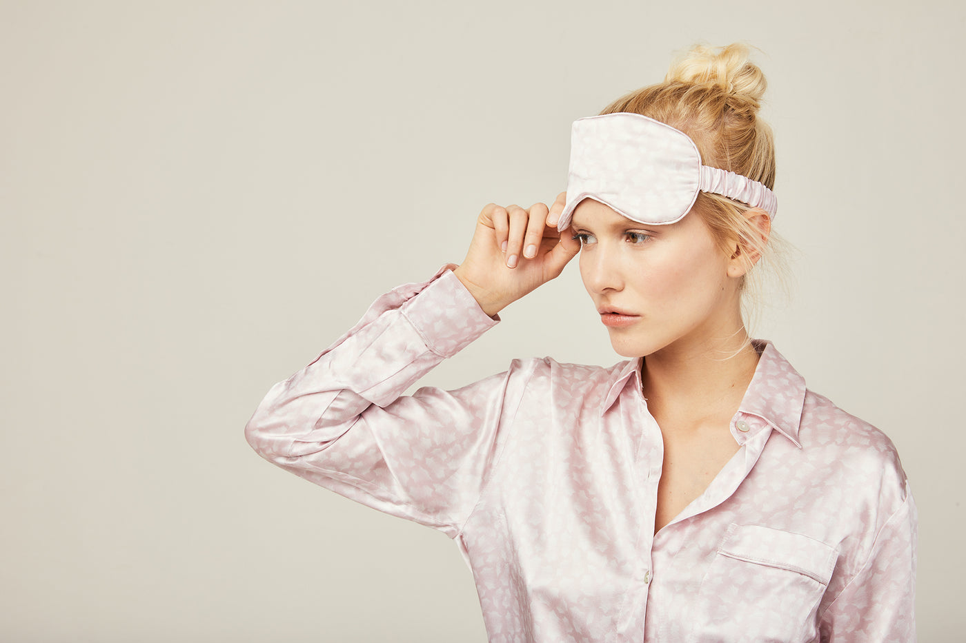 Woman wearing sleep mask in Rosé