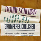Bouneschlupp Tea Towel in English
