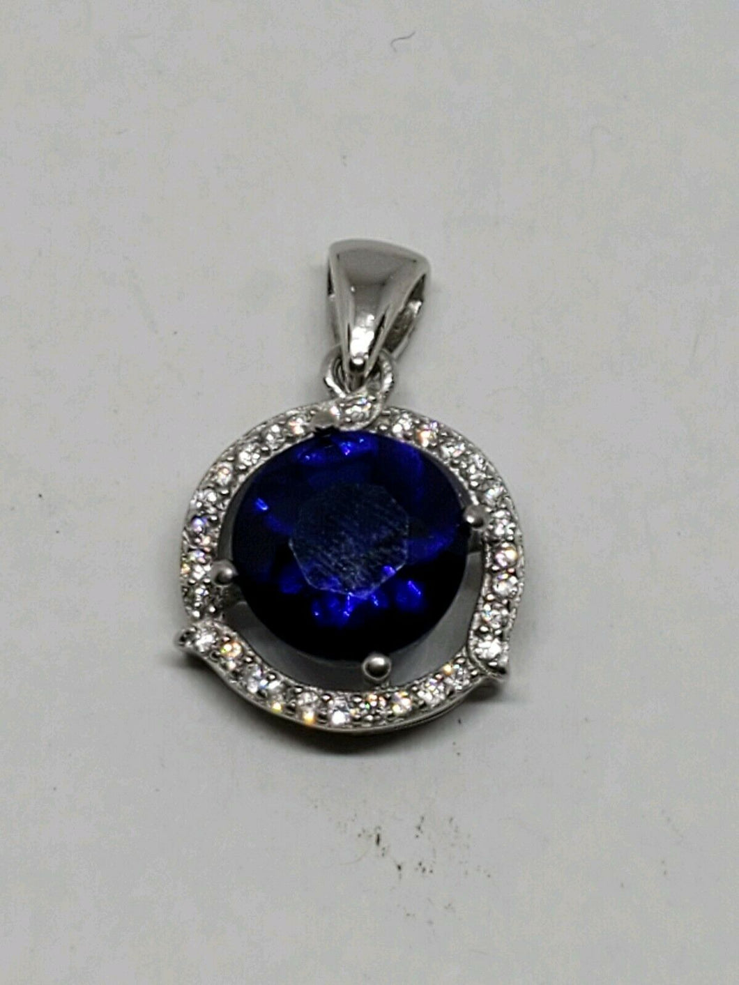 Sterling Silver Round Blue Sapphire White Topaz Halo Pendant