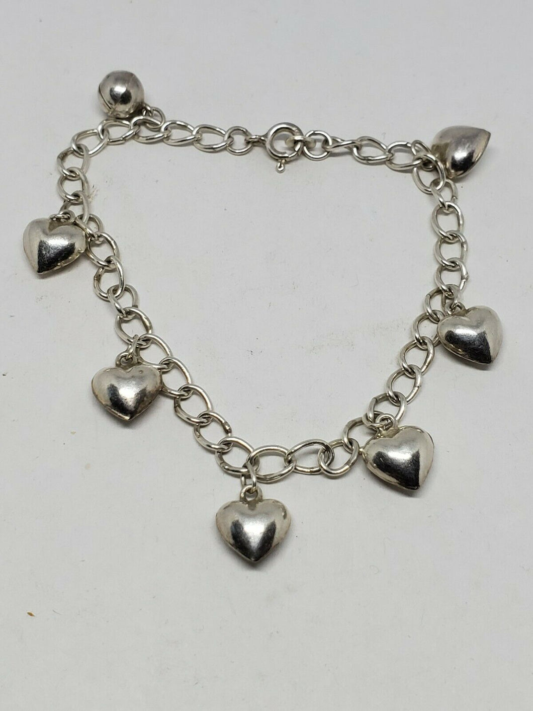 Sterling Silver 7 Charm Puffy Heart Charm Chain Bracelet 7.25