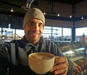 el ATLboy Aaron Cruz enjoying a fresh mug of coffee