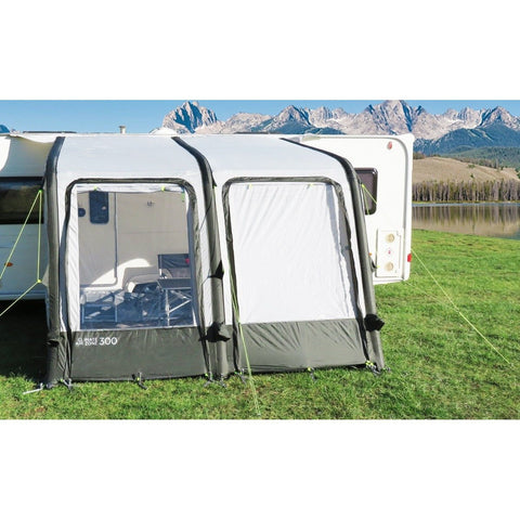 A green and black climate zone air 300 caravan awning by crusader with canopy and support poles. Roll out blinds and inflatable bladders to allow for quick assembly.