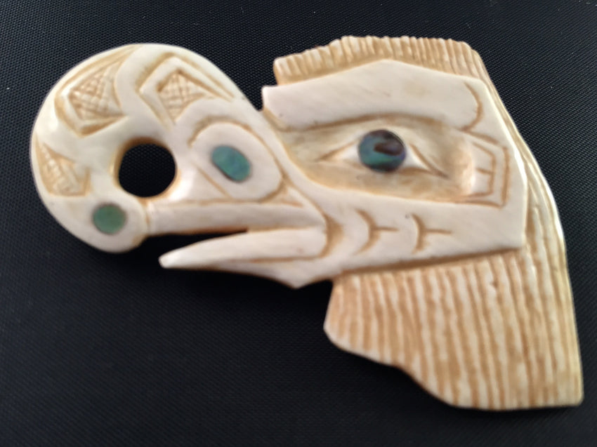 """Crooked Beak of Heaven"" fossilized ivory and abalone pin by Patty Fawn"