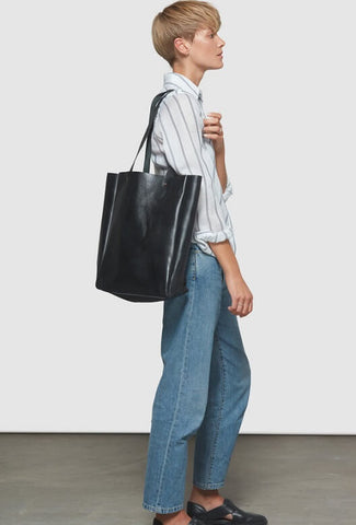 Model with a big black bag