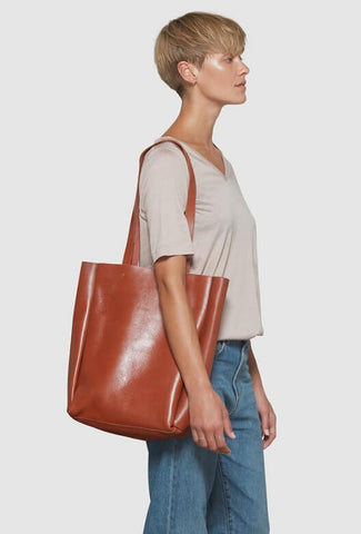 Model with a big brown bag
