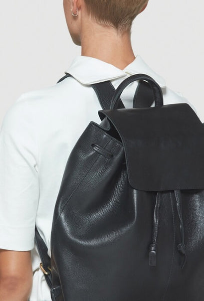 Modeling black leather backpack
