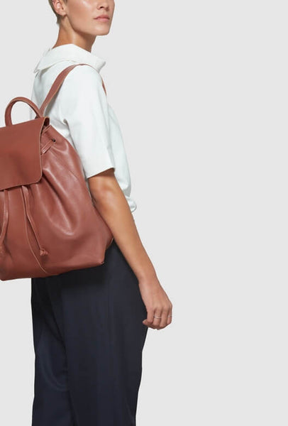 Model with brown backpack