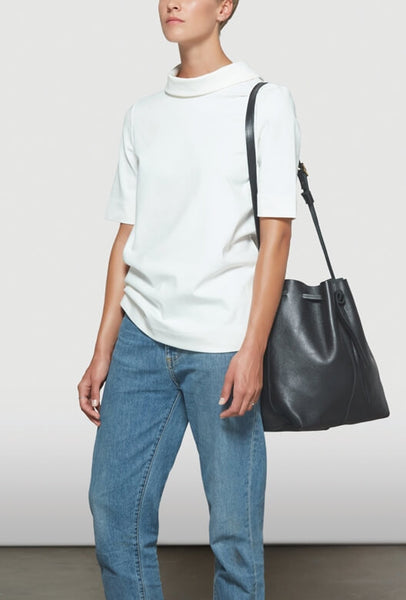 Big black bucket bag on a model