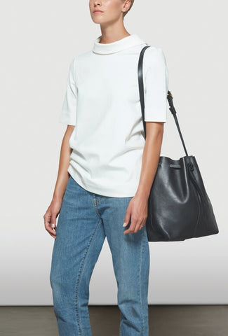 Female with big black bag