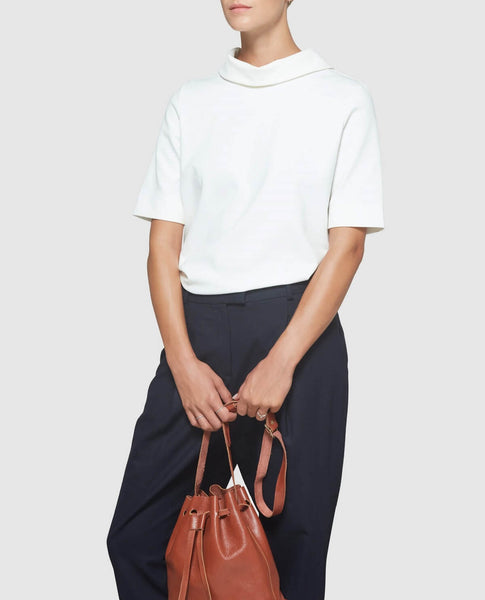 Model with brown bucket bag