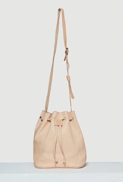 Beige leather bucket bag with strap