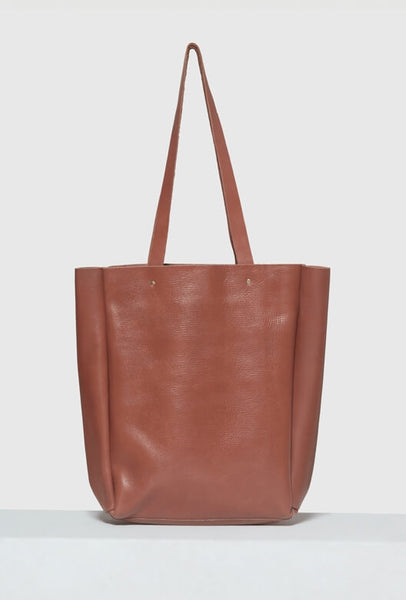 Brown leather tote bag with strap