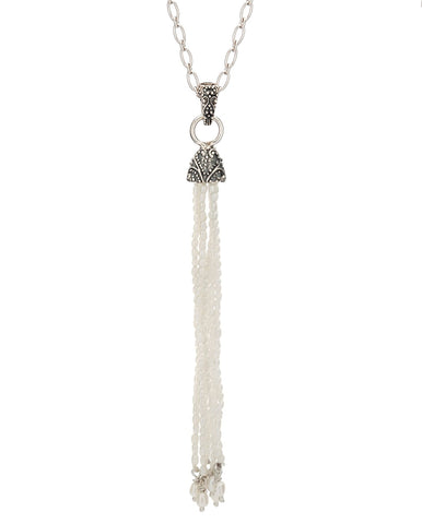 sterling silver pendant featuring a delicate bead tassel hanging from granulation detailing on a hinged bail