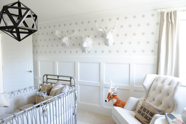 image copyright by photographer; not WFT.  used with permission. depicting the Raleigh white bear head, the Templeton deer head, and Edmonton moose head- all in white in a baby's nursery.