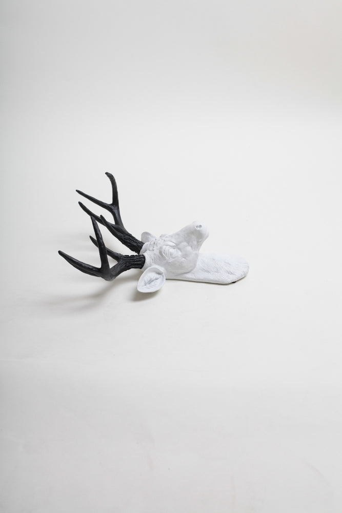 Mini black faux antlers & white stag head wall mount