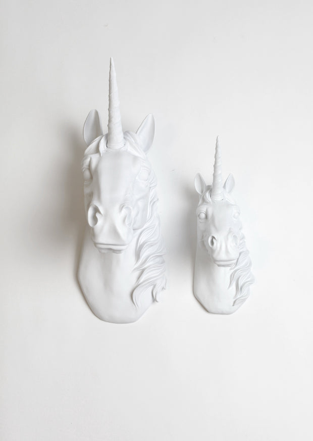 "Large Bayer Unicorn head Measuring 16.25"" tall and the Binx White Unicorn 10"" tall."