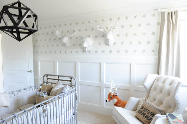 Woods Themed Nursery With White Faux Animal Heads, The Raleigh Bear Head Shown. Chic Baby Room Decoration & White Wingback Chair (Instagram 2017 (C) by @Monikahibbs)