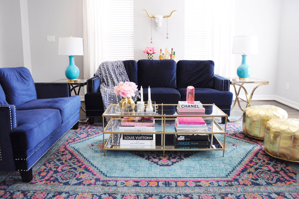 Longhorn Skull Wall Mount, Navy couch, gold leather ottomans, Gold glass Coffee Table. Instagram, 2017 by @OliviaAnnRoberts ( The Savannah White with Gold Horns Shown)