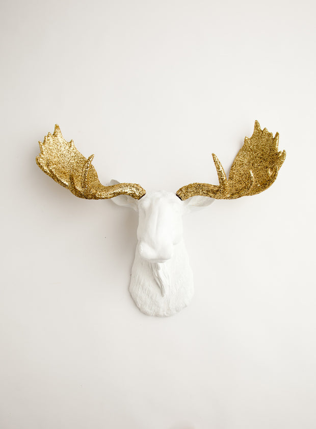 White faux moose head with gold glitter antlers