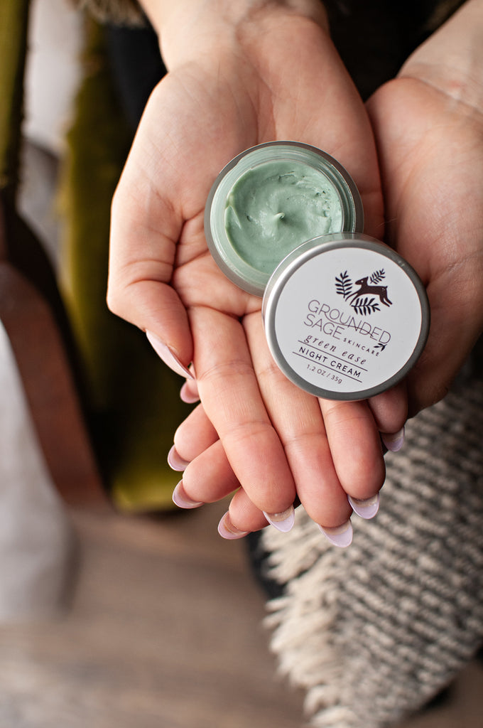 Pastel mint green face cream for calming redness and providing relief for sensitive skin. Artisan Apothecary Skin Care Products Handmade in Canada.