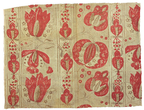 Blockprinted fabric from 18th century France. Red print of natural base.