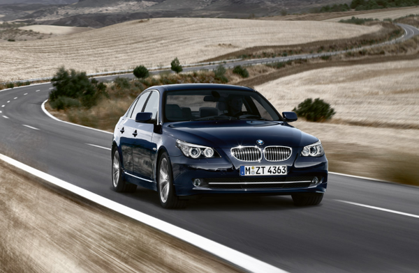 BMW E60 5 Series driving on the country road