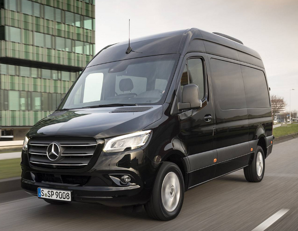 A black Mercedes-Benz Sprinter on the city street