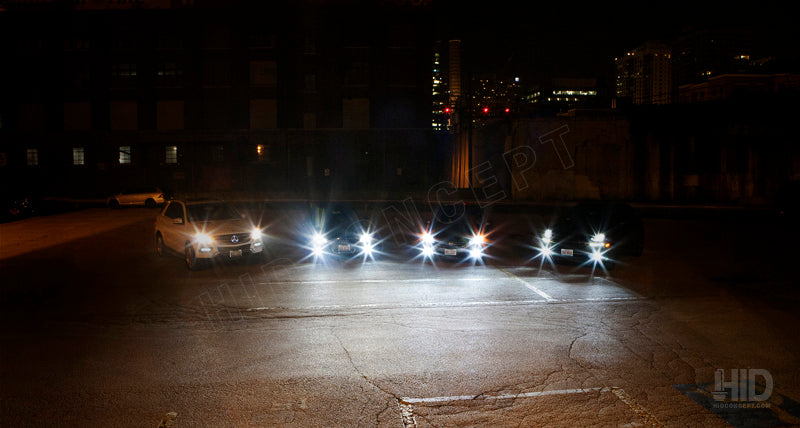 four cars with headlights on