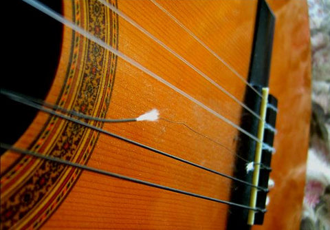 classical guitar with broken single string