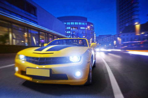 A yellow sports car with Philips Crystal Vision halogen headlight bulbs
