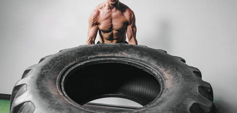 HID Concept a muscle man lifting a gigantic tire
