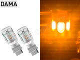 A set of white DAMA MINI LED BA15S Amber bulbs and Light Test