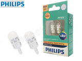 two opened Philips Ultinon LED amber bulbs and package
