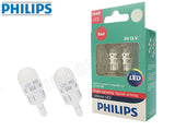 two opened Philips Ultinon LED red bulbs and package