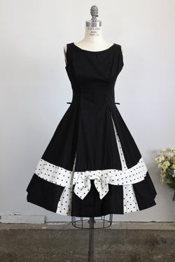 Vintage 1950s Black Fit and Flare Dress With Polkadot Bow