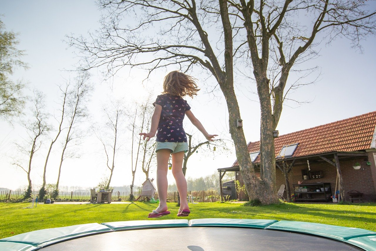 Girl jumping in trampoline
