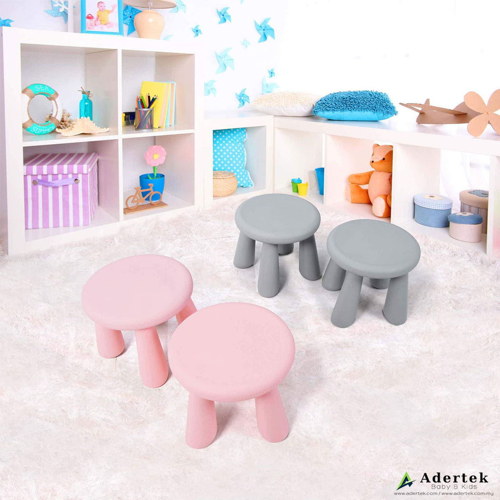 4 Toddler chairs in pink and grey colour on a soft pink carpet.