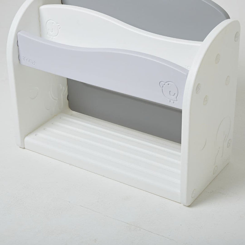 White and grey bookshelf for kids with minimal design and smooth curves.