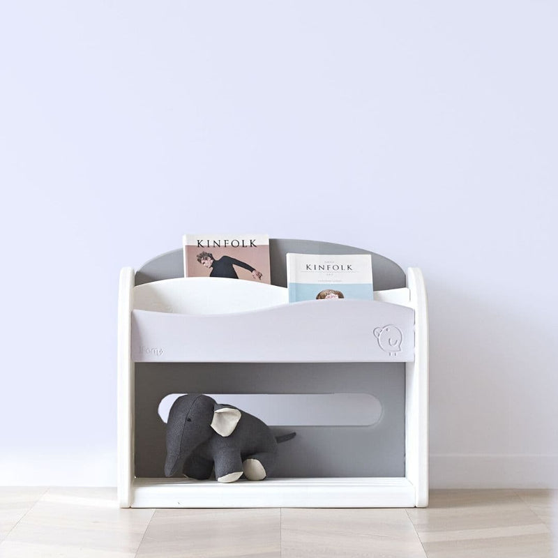 Grey and white bookshelf for kids storing books and children soft toys.