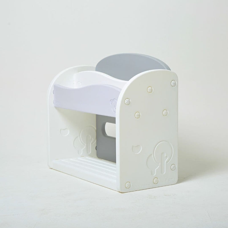 Side view of a white and grey plastic bookshelf for kids with no sharp edges.