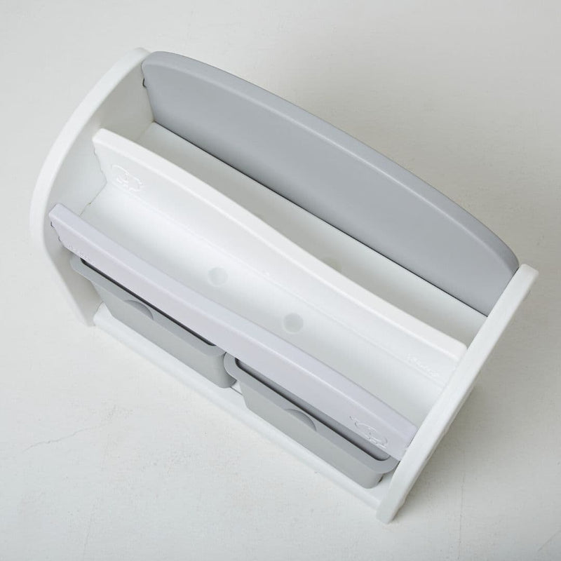 Top view of a white and grey plastic bookshelf for kids.