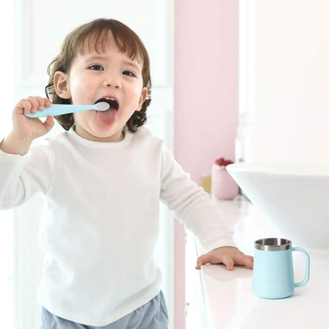 Kid brushing his teeth using Easy Toothbrush