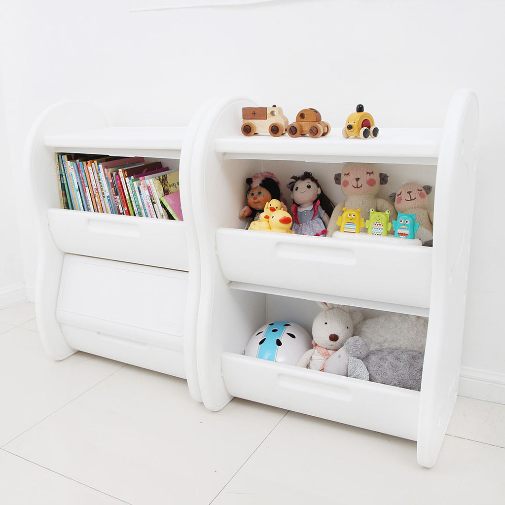 2-level children's storage organiser in white, filled with children's books and toys.