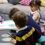 Kids playing and drawing on a multi-functional kids table.