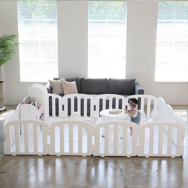 White play yard with modular design which can be easily expanded to fit any baby play mat size.